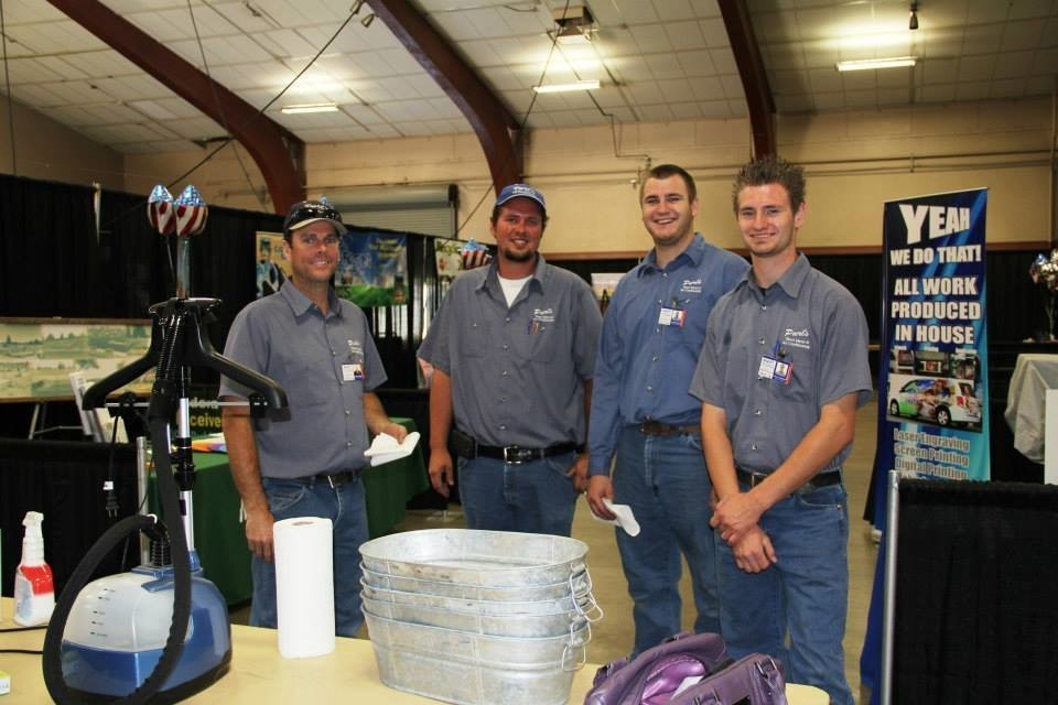 Arthur Neff, Lucas Beeler, Jacob Davidson, and Andrew Davidson setting up at the 2013 Business Extravaganza