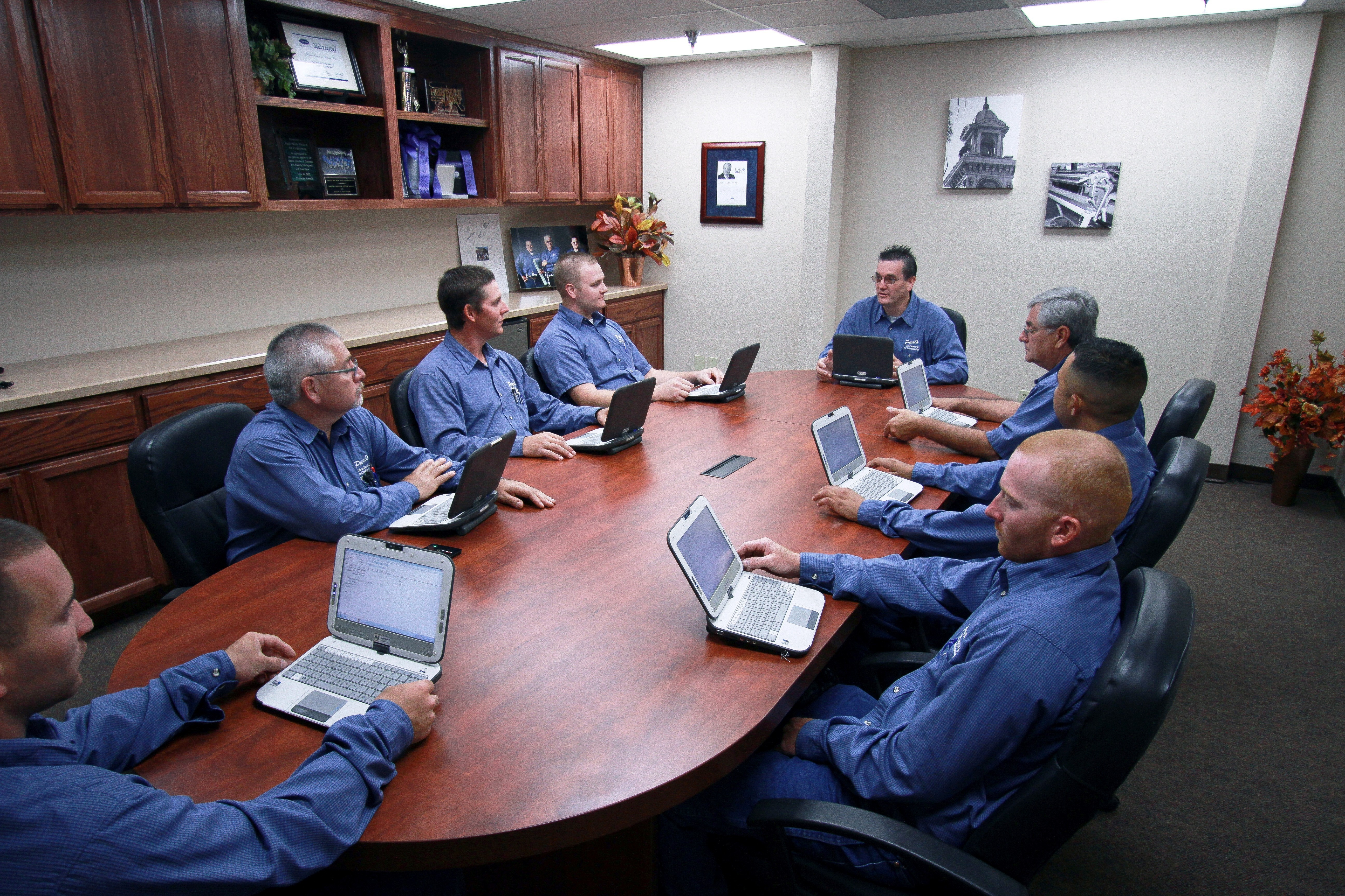 Service Technician Meeting with Computer Tablets