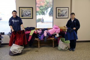 Kids from St. Joachim School helping us count coats!
