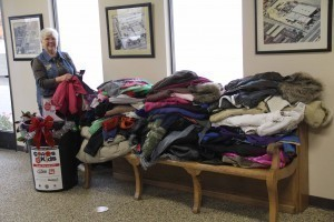 Sheryl Berry sorting 63 coats from Lincoln Elementary School