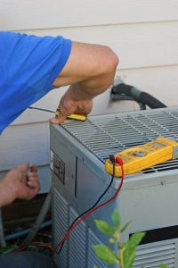 air-conditioner-unit-being-repaired