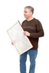 man-with-furnace-filter